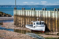 Fishing boat docked in Harbourville on the Bay of Fundy